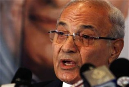Ahmed Shafiq talks during a news conference
