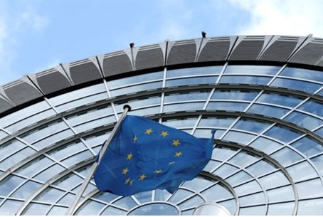 European Union flag flutters outside of the