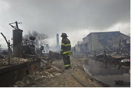 Firefighter stands in Breezy Point after Hurr