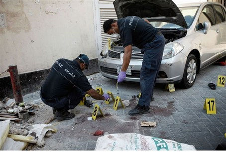 Bahraini police inspect the site of an explos