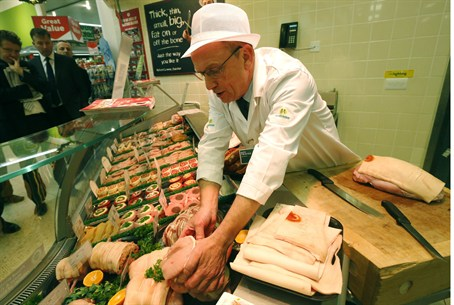 Supermarket prepares meat (illustrative)
