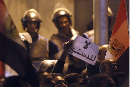 Egyptian police protect palace, sign reads 'N