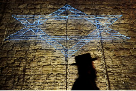 Jewish man walks by Star of David