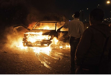 An Egyptian police car set ablaze on Cairo's