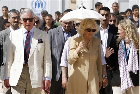 Britain's Prince Charles (L) and his wife Cam