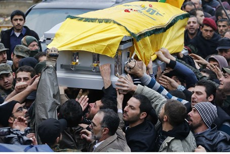 Hezbollah supporters carry the coffin of assa
