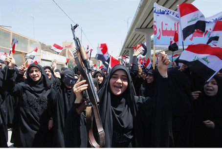 Iraqi Shia women march in support of the gove