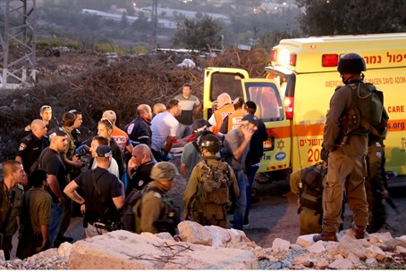 Medics evacuate the injured after Gush Etzion