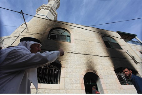 Fire damage to the mosque in Al-Mughayir
