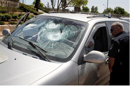 Car windshield smashed in rock attack (file)