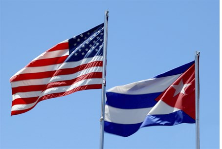 American, Cuban flags (illustrative)