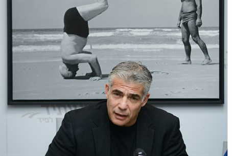 Yair Lapid with picture of David Ben-Gurion