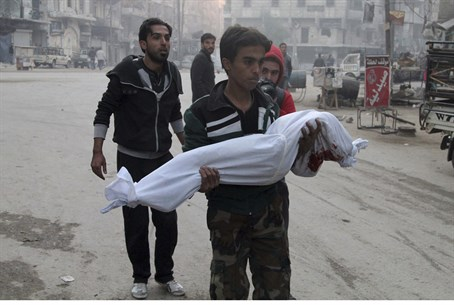 A man holds a child killed by an Assad regime barrel bomb in Aleppo