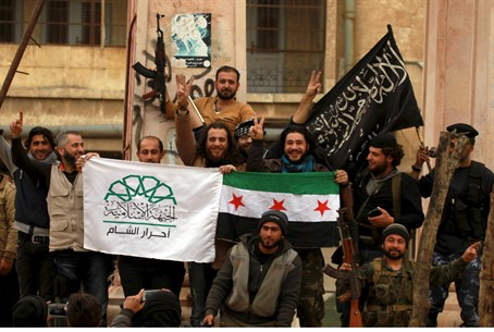 Rebel factions pose with their flags after taking Idlib, Syria (file)