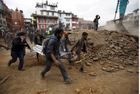 Emergency workers evacuate a body after Nepal earthquake