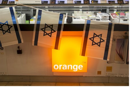 Israeli flags hang over the Orange logo