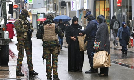 Belgian soldiers and armed police patrol central Brussels