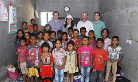 Chief Rabbi and family at GPM project for children in Mumbai slums