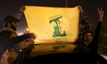 Hezbollah supporters with the group's flag (file)