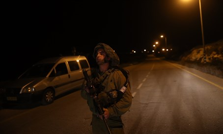 IDF soldier near where Dafna Meir was murdered in Otniel