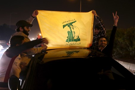 Hezbollah supporters hold a Hezbollah flag