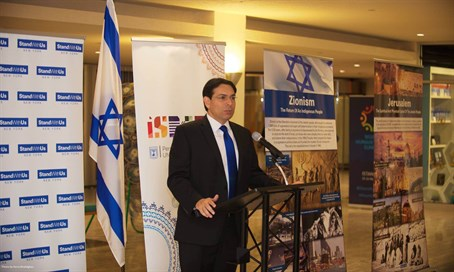 Danny Danon with the exhibit