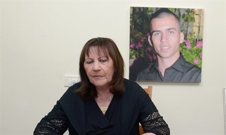 Zehava Shaul with Oron's picture in the background