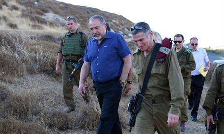 Defense Minister Liberman at the site of the attack