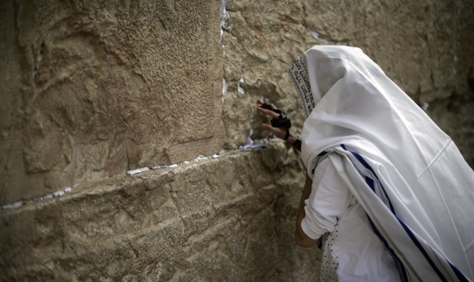 Man prays at the Kotel (Western Wall)