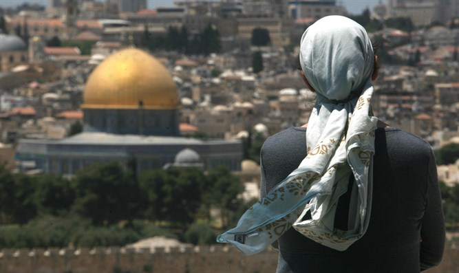 Jewish woman prays on Mount of Olives, overlooking Temple Mont