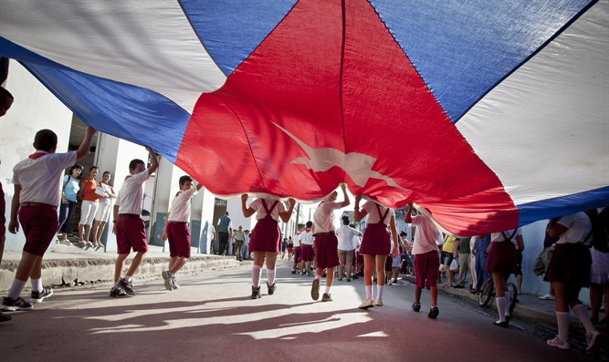 Students parade with Cuban flag in Gibara, Cuba