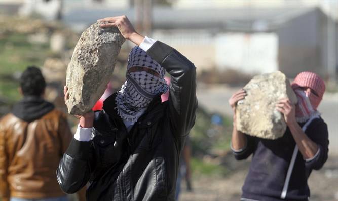 Arab rock throwing terrorists