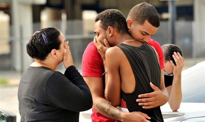 Friends and family of victims of Orlando gayclub shooting react outside police station