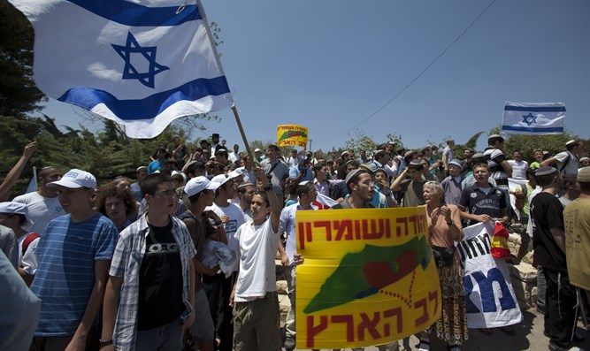 Israelis march in Judea and Samaria