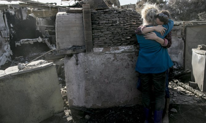 Rama and her daughter embrace amid ruins of their restaurant
