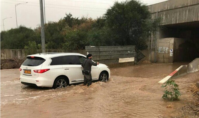 People caught in flooding at Kfar Chabad