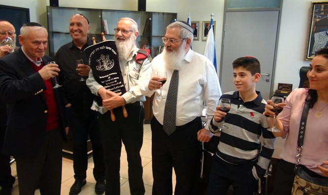 Family of Bar Mitzvah boy gives IDF Torah scroll
