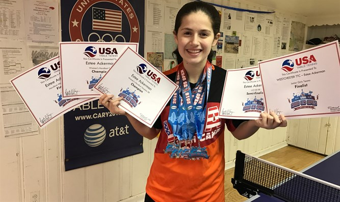 Estee Ackerman holding certificates representing the five medals she won