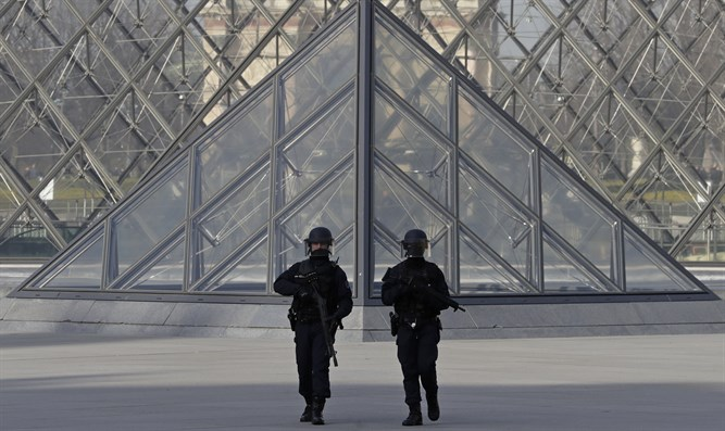 French police secure the site near the Louvre Pyramid