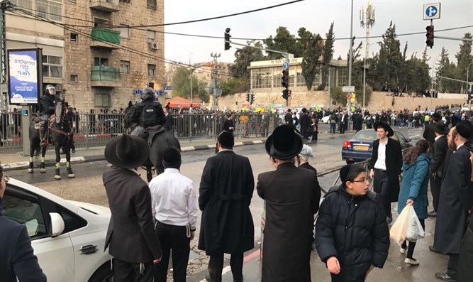 Haredi men protest at Bar Ilan Junction
