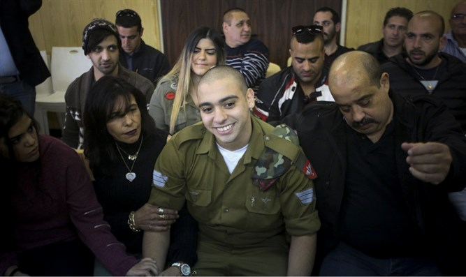 Elor Azariya in court surrounded b family