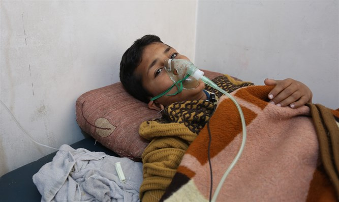 Hassan Dallal, a survivor of the chemical attack in Syria, receiving medical treatment at