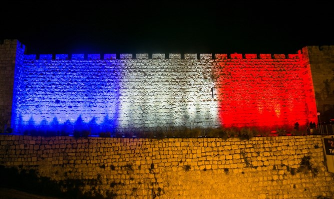 Jerusalem's city walls illuminated with colors of French flag