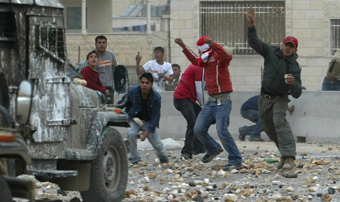 Arab rioter throws bottle