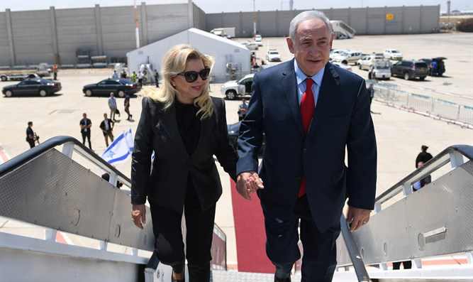 Netanyahus board a plane at Ben Gurion Airport
