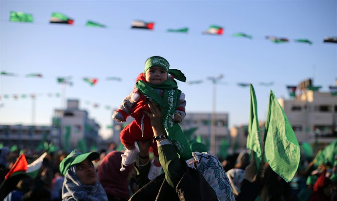 """Pain and destruction"": Hamas mother holds baby aloft"