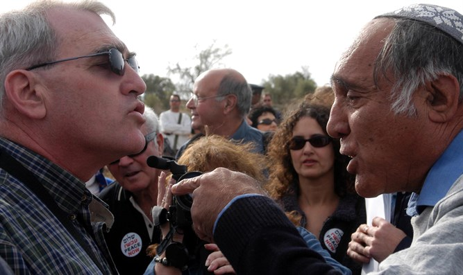 Moshe Zar (R) confronts Peace Now at Gilad Farm