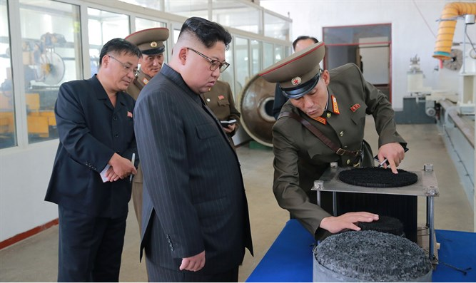 North Korean leader Kim Jong-Un looks on during visit to Chemical Material Institute of th