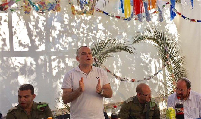 Oded Revivi speaks to Israelis and Palestinian Arabs in his sukkah