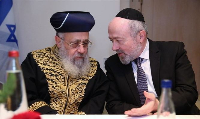 Rabbi Shimon Jacobi (right) and Rabbi Yitzhak Yosef
